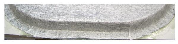Stratifications successives de mat de verre